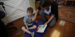 adult examining child's body