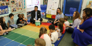 nyc chancellor sitting on floor with young kids