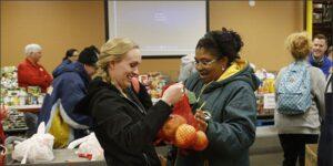two women bonding with fruit
