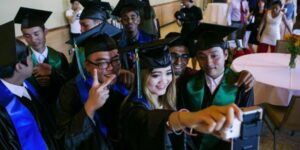 high school graduates wearing cap and gown