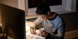 high school student working on homework late at night