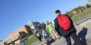 students with backpacks on campus